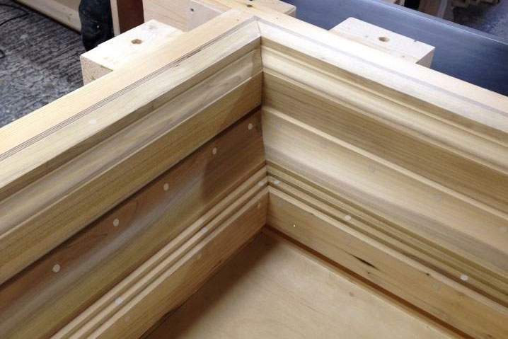 A pilaster cap mould produced using hardwood moulding.